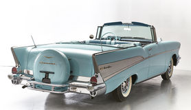 Blue convertible Chevrolet Belair 1957. A '57 Chevy shot from behind in baby blue with spare tire cover Royalty Free Stock Photography