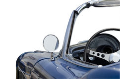 Blue convertible sports car isolated. Blue American convertible sports car isolated from the 1960's half rear view Royalty Free Stock Photos