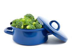 Blue cooking pan with broccoli isolated Royalty Free Stock Photos