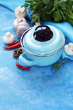 Blue cooking pot and ingredients for soup or stew Stock Photo