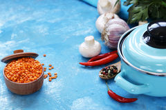 Blue cooking pot and ingredients for soup or stew Stock Images