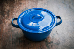 Blue of cooking pot on wooden Stock Images