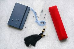 Blue copebook with red box. And crystalls royalty free stock photo