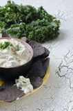 Blue corn tortilla chips. With ranch vegetable dip with kale Stock Photo