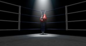 Boxing Corner And Boxing Gloves. The blue corner of a boxing ring with gloves hanging on a pole spotlit on an isolated dark background - 3D render stock illustration