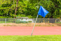 Blue corner flag on an soccer field Stock Photo