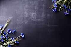 Free Blue Cornflowers And Rye On Old Blackboard From The Top Stock Photography - 72885432