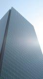 Blue Corporate Building in a Blue Sky. A blue corporate building in the blue sky royalty free stock photos
