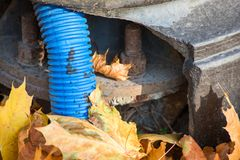 Blue corrugated hose in a broken pole stock photo