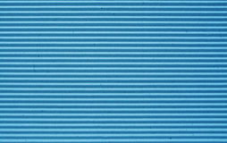 Blue corrugated paper background. Royalty Free Stock Photos