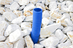 Blue corrugated pipe for electric cable coming out from the grou Royalty Free Stock Photography