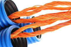 Blue corrugated pipe with orange cables Royalty Free Stock Photos