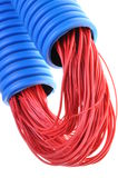 Blue corrugated pipe with red cables Stock Photos