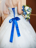 Blue corset bride and the bridal bouquet Stock Photography