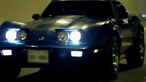 Blue Corvette driving through a tunnel at a night drive. Various shots of blue Corvette during the driving through a tunnel at night stock footage