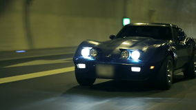 Blue Corvette driving through tunnel stock video