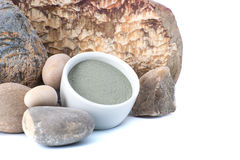 Blue cosmetic clay on a background of natural stones, is located Royalty Free Stock Image