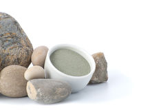 Blue cosmetic clay with stones on a white background. Stock Image