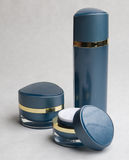 Blue cosmetic containers. A closeup view of stylish, blue cosmetic containers and bottles Royalty Free Stock Photo
