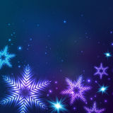 Blue cosmic snowflakes Christmas abstract Stock Image