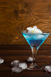 Blue cosmopolitan cocktail on wooden background Stock Photos
