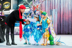 Blue costume winners. LAS PALMAS, SPAIN-FEBRUARY 12:Isabel Garcia Bolta(l) gives diploma to Ezequiel, Paula and Carla, from Canary Islands, during The Children's Royalty Free Stock Photos