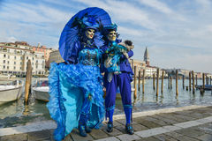 Blue costumed masked couple Stock Photos
