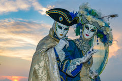 Blue costumed masked couple Stock Image