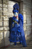 Blue costumed masked woman. At Doge's Palace  in Venice Royalty Free Stock Photo