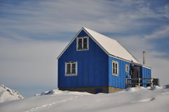 Blue cottage covered by snow, Greenland Stock Images