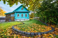 Blue Cottage of Golf Club. And a golf course in autumn leaves in Plyos on an autumn day Royalty Free Stock Images