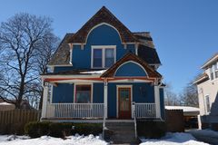 Blue Cottage in Snow Royalty Free Stock Photography