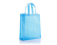 Blue cotton bag. Studio shot isolated on white Royalty Free Stock Photography