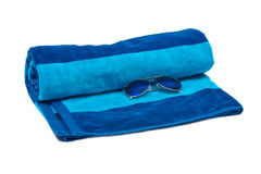 Blue cotton beach towel and sunglasses. Isolated on white background Stock Image