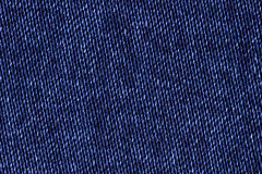 Blue cotton denim jeans fabric texture background, close up Stock Image