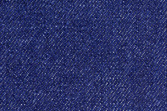 Blue cotton denim jeans fabric texture background, close up Stock Photos