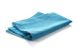 Blue cotton napkin. Blue folded cotton napkin on a white background Stock Photo