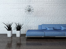 Blue couch against stone wall Stock Images