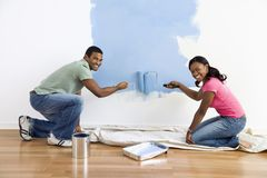 blue couple painting wall Στοκ Εικόνα