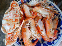 Blue crabs and shrimp or prawn with spicy seafood sauce Stock Photo