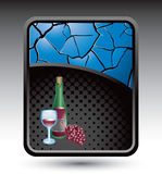 Blue cracked backdrop with wine glass and bottle Stock Photography