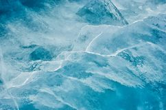 Blue cracked surface of the ice surface. On the lake Baikal stock photo