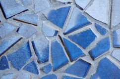 Blue Cracked Tiles In Grout. Blue tile in pieces set in grout Royalty Free Stock Image