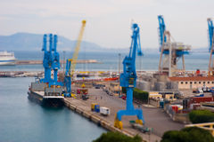 Blue crane. Some blue cranes at port in tilt shift Royalty Free Stock Image