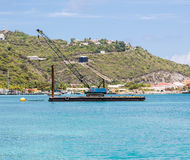 Blue Crane on Barge in Caribbean Royalty Free Stock Images