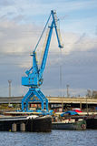 Blue crane in Gent harbor. Blue crane with living boats in front in `Dok Noord` harbor along river Scheltd in Ghent, Flanders Royalty Free Stock Photo