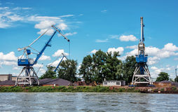 Blue cranes in cargo port, Danube river Royalty Free Stock Photography