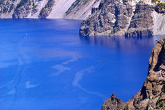 Blue Crater Lake Rim White Boat Oregon Royalty Free Stock Photography
