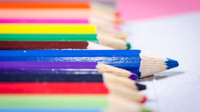 Blue crayon striking. Royalty Free Stock Photo