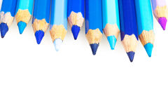 Blue crayons on the white paper Stock Image
